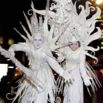 Snow Queen and Jack frost on stilts